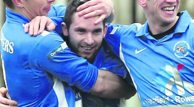 Jason McCartney is mobbed by team-mates