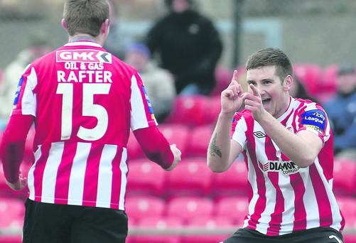 Michael Rafter celebrates his goal with Patrick McEleney