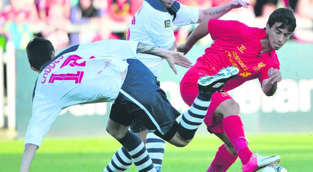 Aiden Watson tackles Liverpool ace Suso at Ravenhill last August