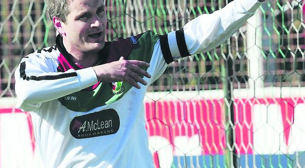 Glentoran's Colin Nixon celebrates a goal during Saturday's game at the Oval in Belfast