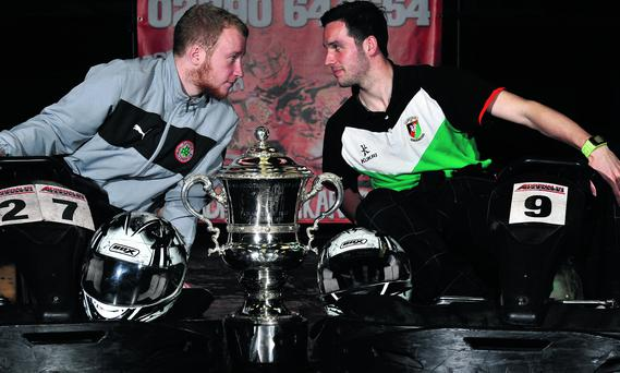 Glentoran striker Andy Waterworth pictured with Cliftonville striker Liam Boyce at Adrenalin Karting in Belfast ahead of today's Irish cup final