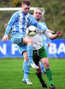 Warrenpoint's Kenny Kearns in action with DC's Paul McAreavey