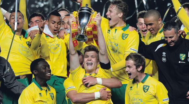 LONDON, ENGLAND - MAY 13: Cameron McGeehan of Norwich lifts the FA Youth Cup and celebrates with the team during the FA Youth Cup Final Second Leg match between Chelsea and Norwich City at Stamford Bridge on May 13, 2013 in London, England, (Photo by Charlie Crowhurst/Getty Images)