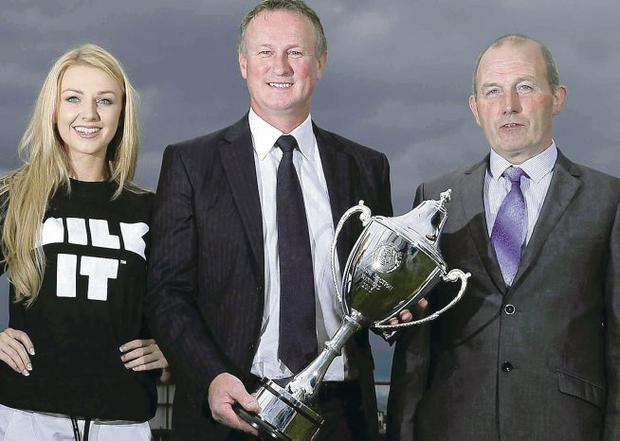 Trophy time: Northern Ireland boss Michael O'Neill (centre) with Miss NI Meagan Green and Dairy Council chairman Harry O'Neill
