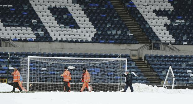 Snow joke: a move to summer football would avoid scenes like this at Windsor Park