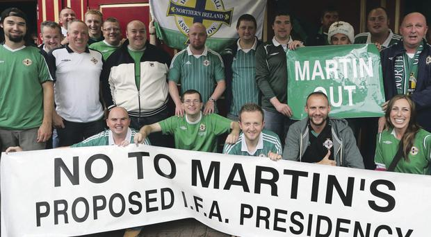 Protest: Northern Ireland fans make their views clear on David Martin