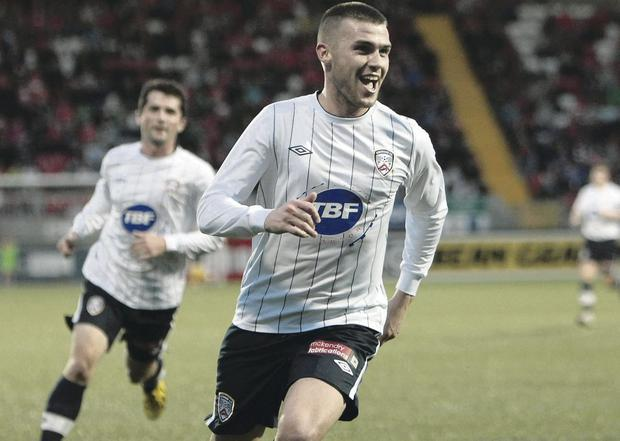Winning feeling: Stephen Lowry celebrates giving Coleraine the lead at Solitude last night