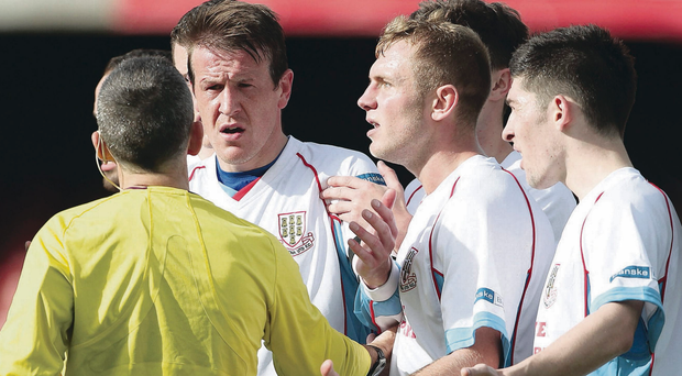 Seeing red: Referee Hugh Carvill sends off Allan Jenkins, one of a number of decisions blasted by Ballymena United boss Glenn Ferguson