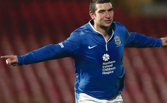 Linfield's Matthew Tipton celebrates scoring against Cliftonville during Tuesday night's Co Antrim Shield semi-final at Windsor Park