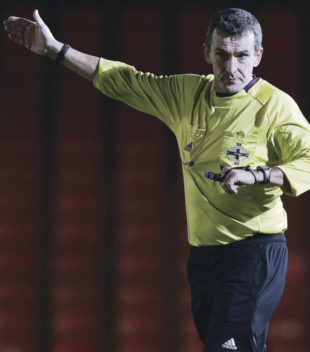 Referee Hugh Carvill during Tuesday night's Co Antrim Shield semi-final at Windsor Park