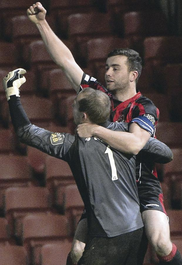 Match winner: Colin Coates' penalty saw Crusaders beat Linfield 10-9 on spot kicks on Tuesday