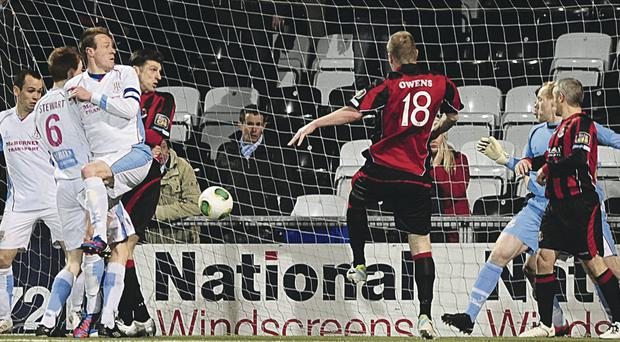 Jordan Owens heads in Crusaders winner to book their place in the NIFL Lague Cup final, where they will play Cliftonville next month