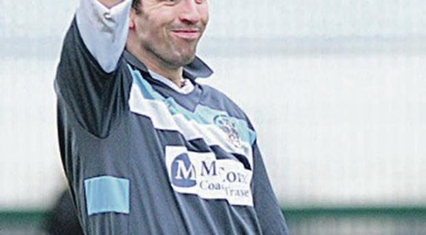 On the up: Lisburn Distillery's Glen Upton celebrates his goal