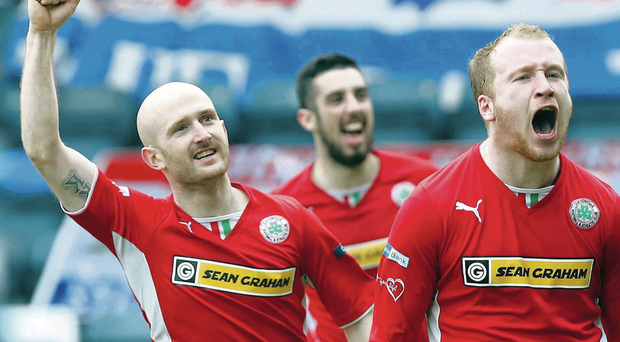 Ryan Catney and Joe Gormley set off in pursuit of Cliftonville's opening scorer Liam Boyce