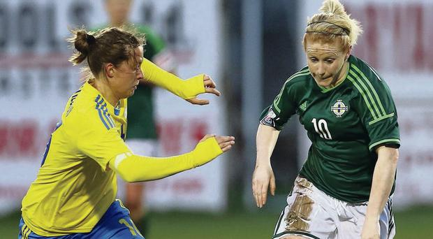Girl power: Northern Ireland's Rachel Furness runs at the Sweden defence during World Cup qualifier