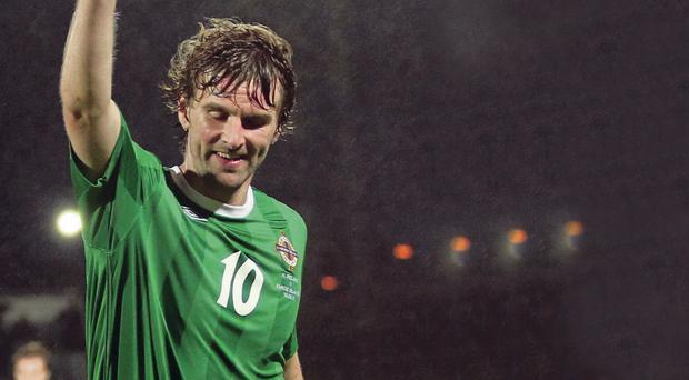 Golden night: Paddy McCourt celebrates his brace against the Faroes in August 2011