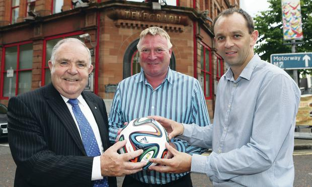 On the ball: marking the Belfast Telegraph's continued sponsorship of Championships 1 and 2 are (from left) Championship Committee Chairman Fred Magee, Group Sports Editor Jim Gracey and NI Football League Marketing and Communications manager Graeme Beggs