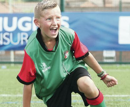 Glory day: The delight on Callum Marshall's face is plain to see after his six-goal haul against Bertie Peacock Youth gave Glentoran victory in the under-10 section of the Foyle Cup
