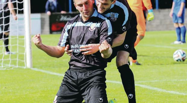 Winning feeling: Gavin Taggart celebrates with Matthew Tipton after the Ballymena striker nodded home his second goal of the day