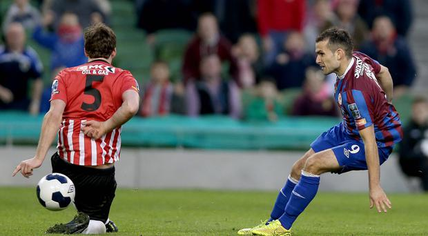 Striking lucky: St Pat's Christy Fagan knocks the ball past Derry City's Ryan McBride to open the scoring in the FAI Cup final