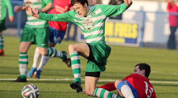 On the slide: Donegal Celtic's Danny Wallace finds himself under pressure from Owain Beggs of Ards