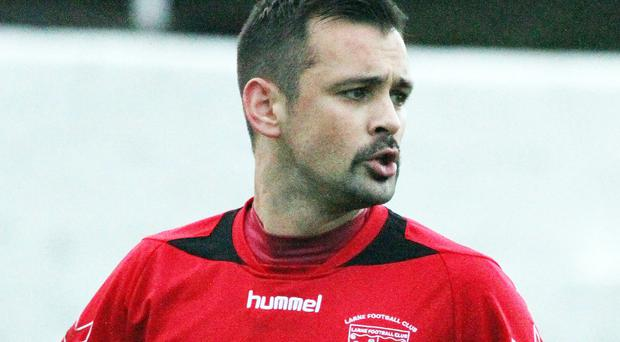 Larne's Scott Irvine was badly injured after after a sickening collision with the perimeter wall during Saturday's Irish Cup tie against local rivals Carrick Rangers, which was immediately abandoned