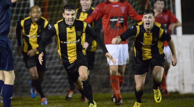 Winning smile: Carrick's Conor McCluskey celebrates his goal