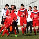 Ballyclare's Andrew Doyle celebrates finding the net against Lisburn Distillery