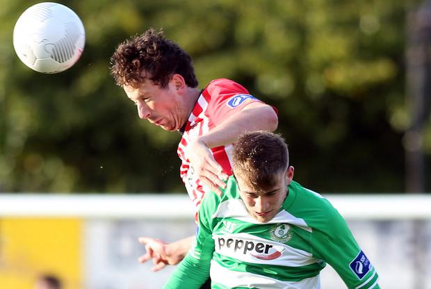 Head first: Derry City's Shane McEleney gets above Gareth McCaffrey of Shamrock Rovers at the Brandywell