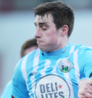 Sunday game: Cliftonville's David McDaid and Warrenpoint Town's John Boyle will meet again tomorrow in a rare Sunday fixture