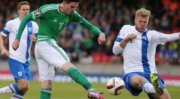Hot streak: Kyle Lafferty scores the first of his two goals in the 2-1 victory over Finland at Windsor Park in March
