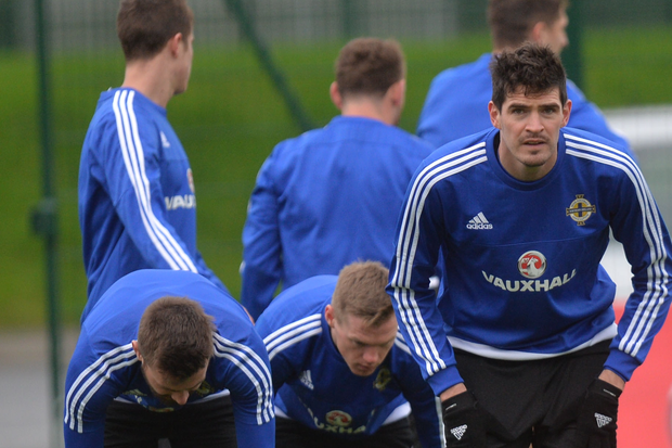 Fighting fit: Kyle Lafferty and his Northern Ireland team-mates at yesterday's training session in Belfast