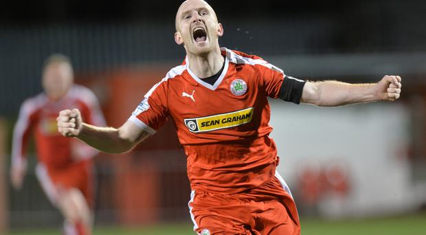 Back of the net: Cliftonville midfielder Ryan Catney celebrates his sensational strike against Glentoran