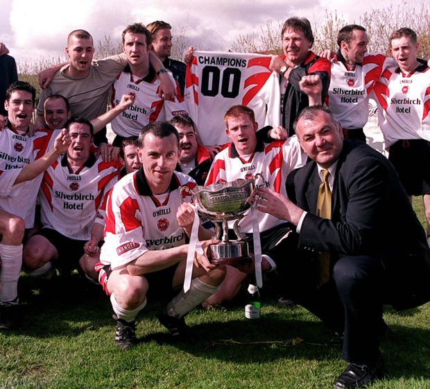 Champions: Omagh Town captain, Eamonn Kavanagh and manager Roy McCreadie hold the Smirnoff First Division Championship trophy at St Julian's Road back in 2000