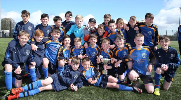 At the double: St Columb's College celebrate double success as both captains Conall Houston (U12) and Jack Malone (U16) celebrate victory in the Inspiresport Senior U12 and U16 Cup during the Inspiresport Schools Football Finals Day at the Ballymena Showgrounds