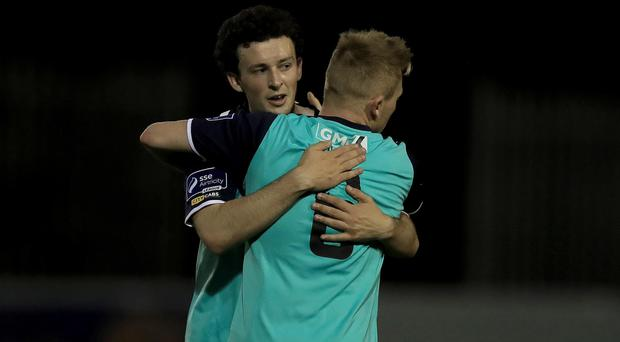 On target: Barry McNamee gets a hug from Conor McCormack
