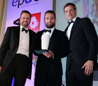 Keeping fine: Glenavon's Jonny Tuffey collects the Goalkeeper of the Year award from Uhlsport's Paul Sherratt and Northern Ireland goalkeeper Roy Carroll