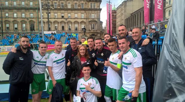 Team effort: The Northern Ireland homeless side celebrate their 10-2 victory over Switzerland at the World Cup in Scotland, including coach Terry Moore (right)