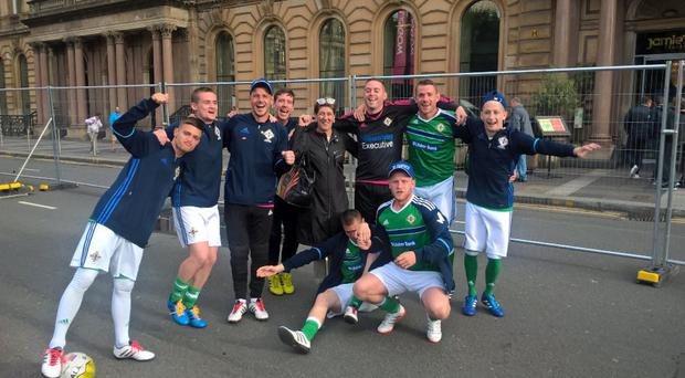 Party time: The Northern Ireland lads enjoy the atmosphere yesterday