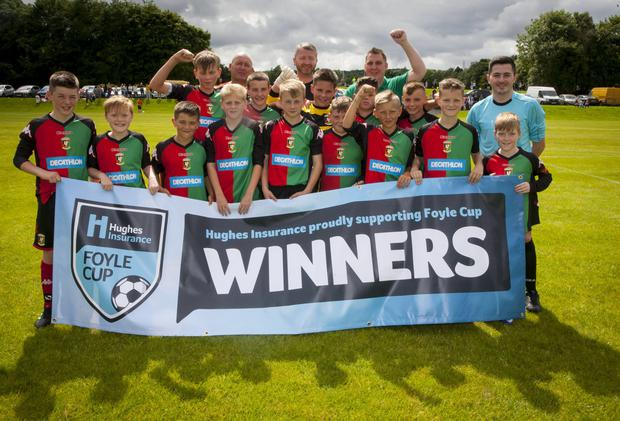 Winning formula: The Glentoran Under-12 squad celebrate their semi-final victory over Ballinamallard United in the Hughes Insurance Foyle Cup yesterday