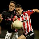 Race is on: Derry City's Nathan Boyle battles with Lee Grace