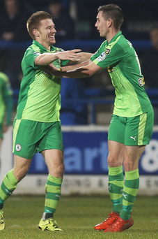 Green machine: Stephen Garrett celebrates with Daniel Hughes after scoring for Cliftonville