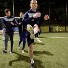 Best foot forward: Portstewart's John Neill limbers up in training