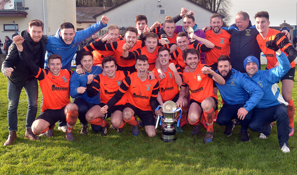 Glory boys: Dollingstown players celebrate their Bob Radcliffe Cup success