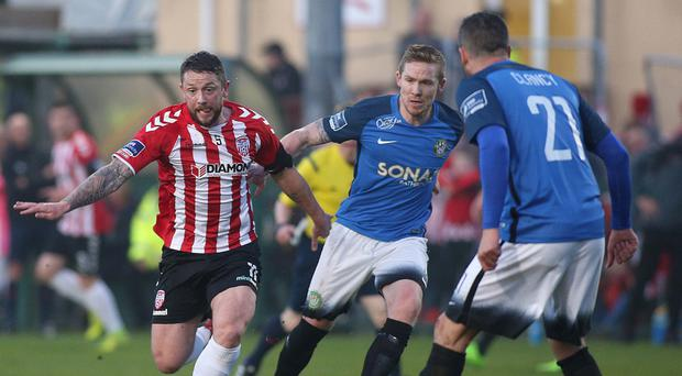 Pressure on: Derry City's Rory Patterson is closed down by Bray duo Conor Kenna and Tim Clancy