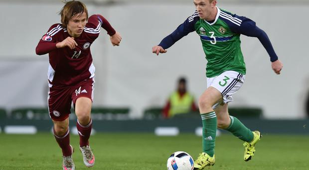 Belfast bound: Latvia midfielder Janis Ikaunieks, taking on Northern Ireland's Shane Ferguson, will be in the FK Liepaja side that hopes to rock Crusaders