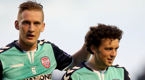 On the up: Derry's Ronan Curtis and Barry McName