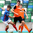 Looking up: Carrick's Mark Surgenor taking on Linfield