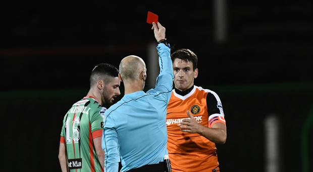 Red-faced: Mark Surgenor is accidentally shown a red card