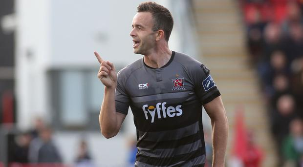 On target: Dundalk's Robbie Benson celebrates scoring earlier this season.
